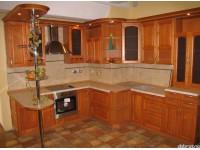 """Кухня - kit_0001 - Кухня с фасадом из натурального дерева - ольхи. Стиль классический. Фасад тонирован, цвет фасада - """"Вишня Оксфорд"""". Слева - барная стойка. Кухня примечательна еще тем, что изящно обыгрывает выступающий угол - колонну.<br>Для расчета цены подобной кухни укажите код этой кухни в заявке в графе """"Доп. информация"""" <a class=""""kuhni-foto-link"""" title=""""Расчет кухни онлайн"""" href=""""http://dobrotno.com.ua/zakazat-dizayn-kuhni"""" target=""""_blank""""> Рассчитать кухню</a>"""